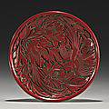 A carved 'birds and flower' cinnabar lacquer dish, ming dynasty (1368-1644)