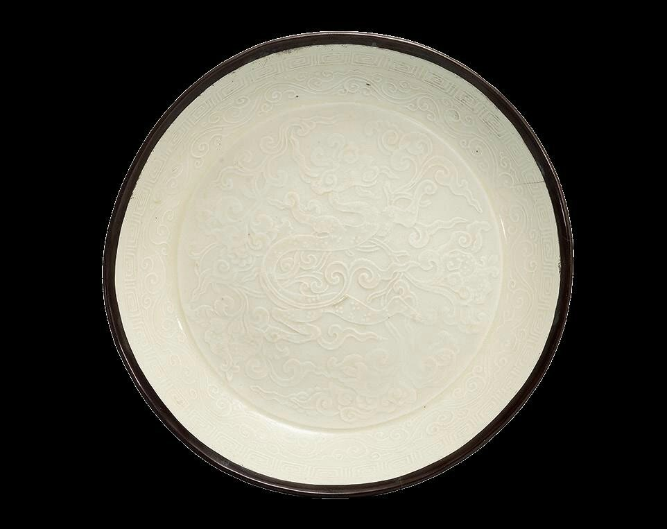 A rare Ding moulded 'chilong' dish , Jin dynasty (1115-1234)