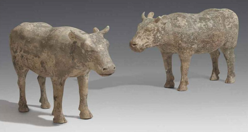 A pair of large grey pottery figures of buffalos, Han dynasty (206 BC-AD 220)