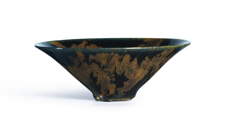 A 'Henan' russet-splashed black-glazed conical tea bowl, Song Dynasty