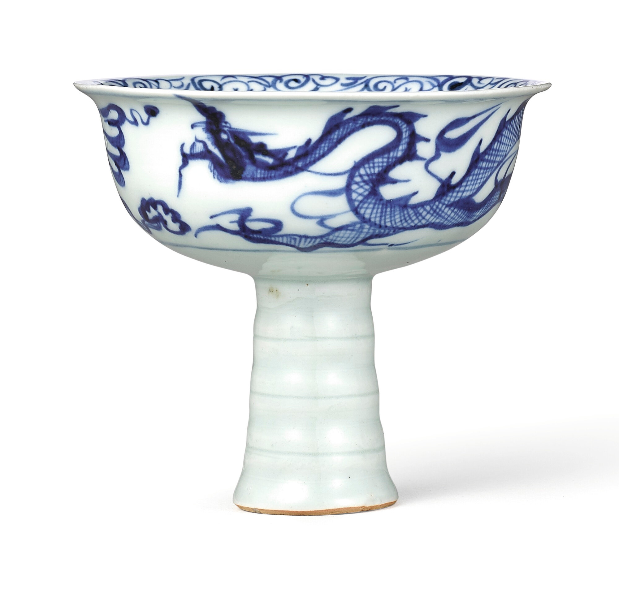 A superb and rare blue and white moulded 'Dragon' stem cup, Yuan dynasty (1279-1368)