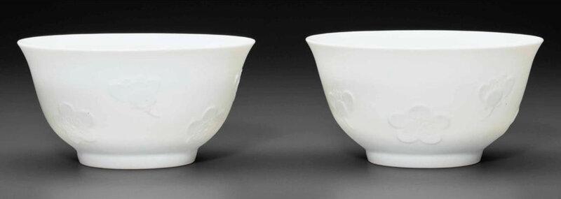 A rare pair of white-glazed molded 'Prunus blossom' bowls, 18th century