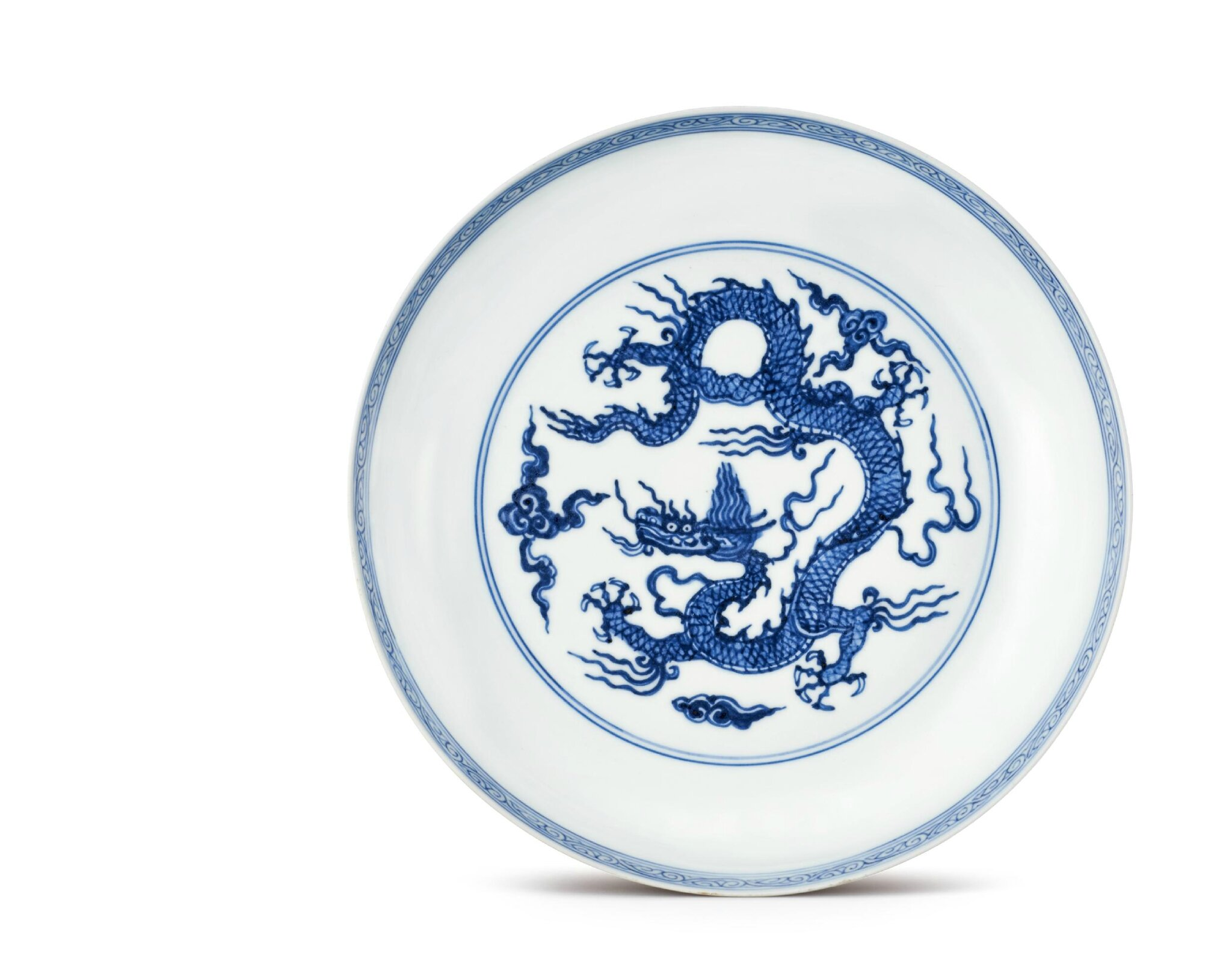 "A rare Ming blue-and-white ""dragon"" plate, Hongzhi six-character mark and of the period (1488-1505)"