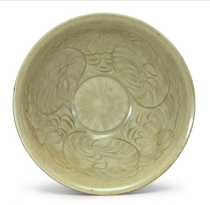 A carved 'Longquan' celadon-glazed bowl, Northern Song dynasty (960–1127)