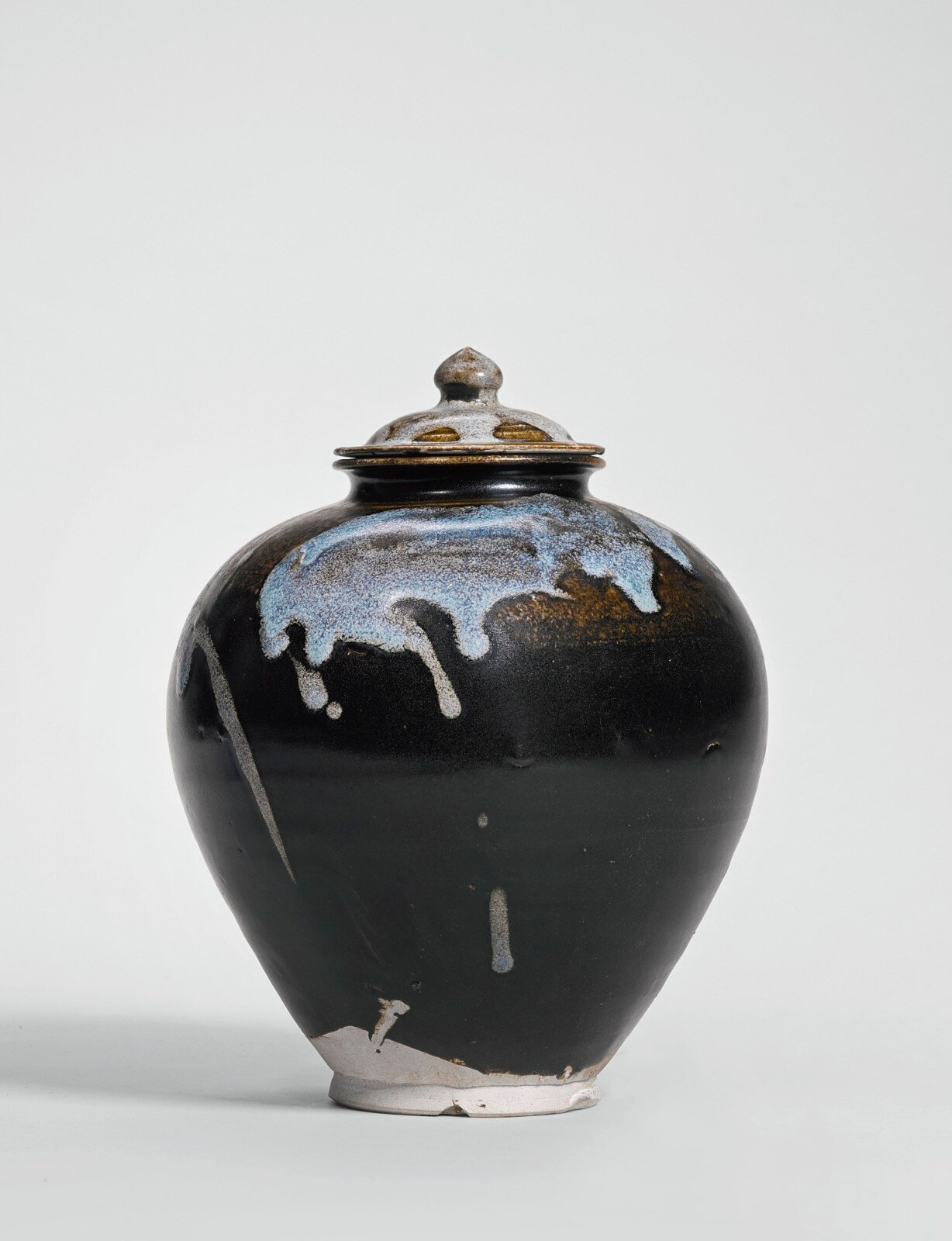 A phosphatic-splashed jar and cover, Tang dynasty (618-907)