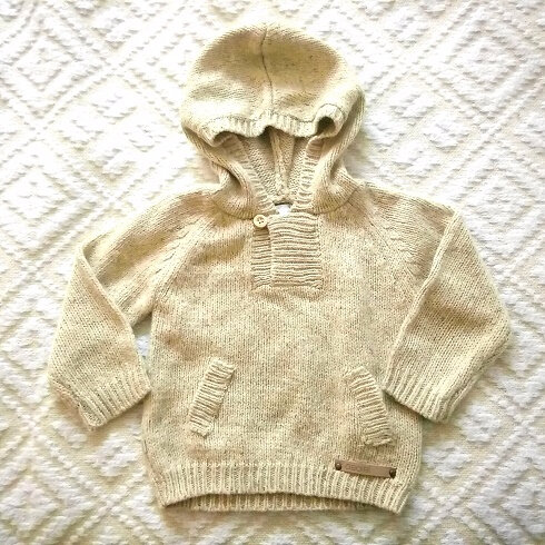 Pull fausses poches, 1 an