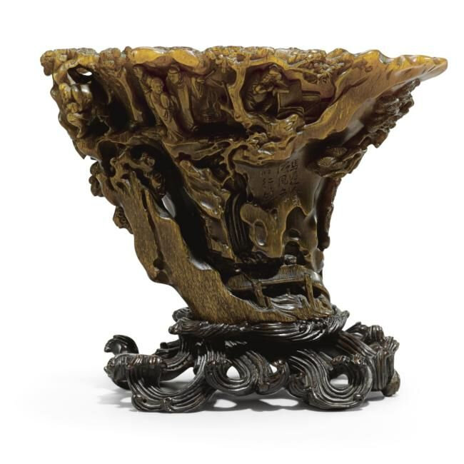Lot 18. An exceptionally carved, inscribed rhinoceros horn libation cup, 17th century; 16.7cm., 6 5/8 in. Estimate 300,000—500,000 GBP. Lot Sold 421,250 GBP to an Asian Trade. Photo Sotheby's