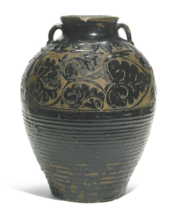 A large 'Cizhou' carved black-glazed jar, Yuan-Ming dynasty
