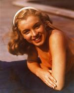 1946-04-04-pool_sitting-swimsuit_red-012-1-by_richard_c_miller-1