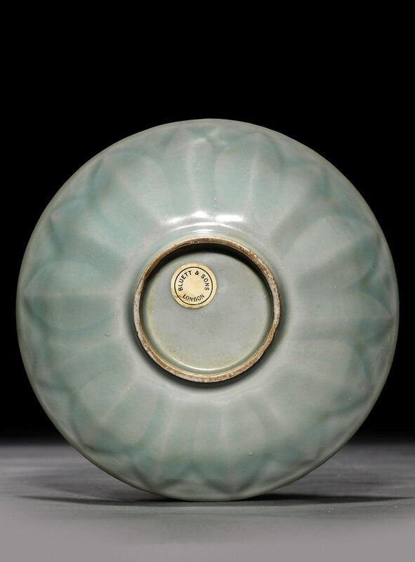 A small moulded Longquan celadon 'lotus' dish, Southern Song dynasty (1127-1279)