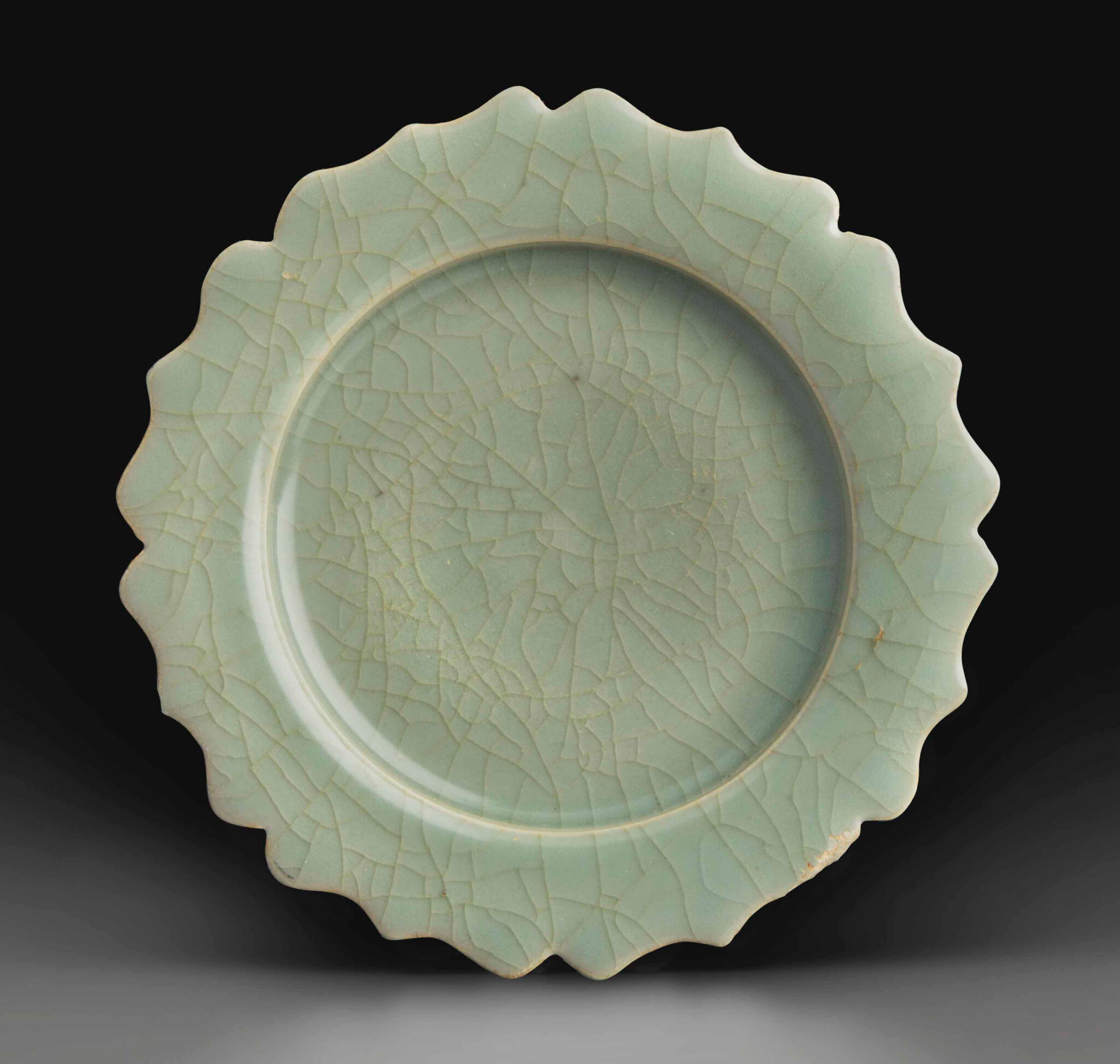 A rare Longquan celadon Guan-type dish with foliate rim, Southern Song dynasty (1127-1279)