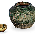 A green-glazed jar and a sancai-glazed wine cup, tang dynasty (618-907)