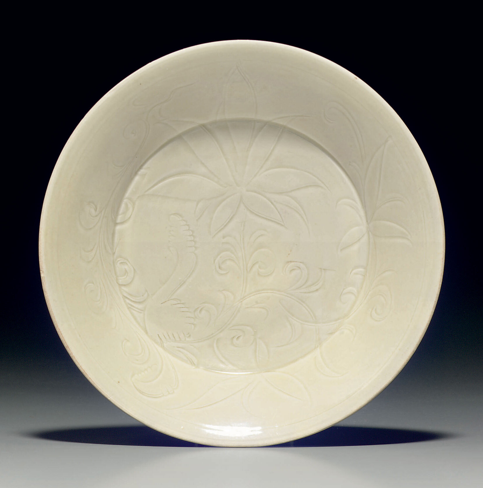 A rare carved Dingyao dish, Northern Song Dynasty (960-1127)