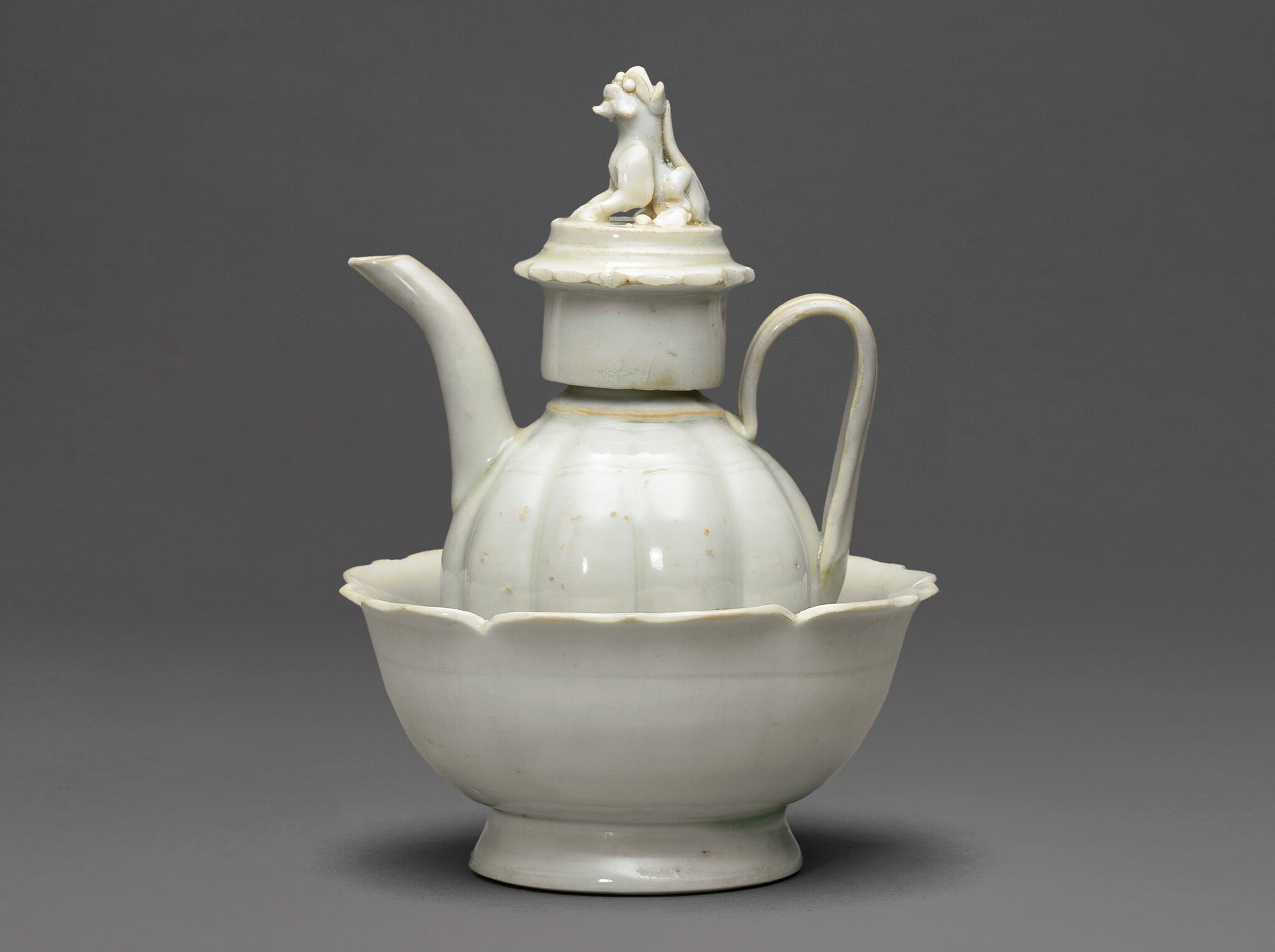A small Qingbai lobed ewer and cover with warming bowl, Song dynasty (960-1279)