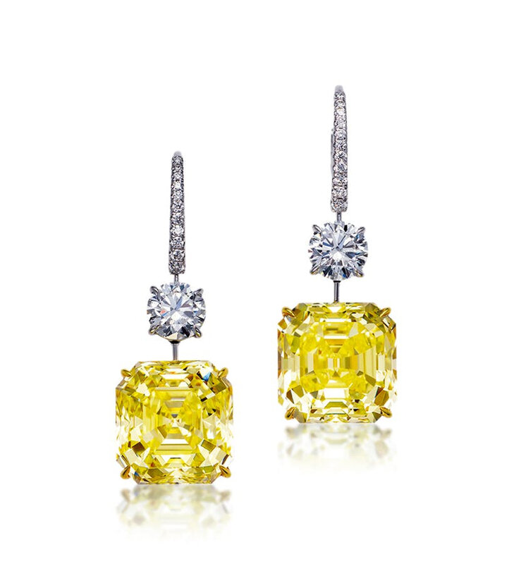 A pair of 13.35 and 12.03 carat fancy intense yellow diamond and diamond ear pendants