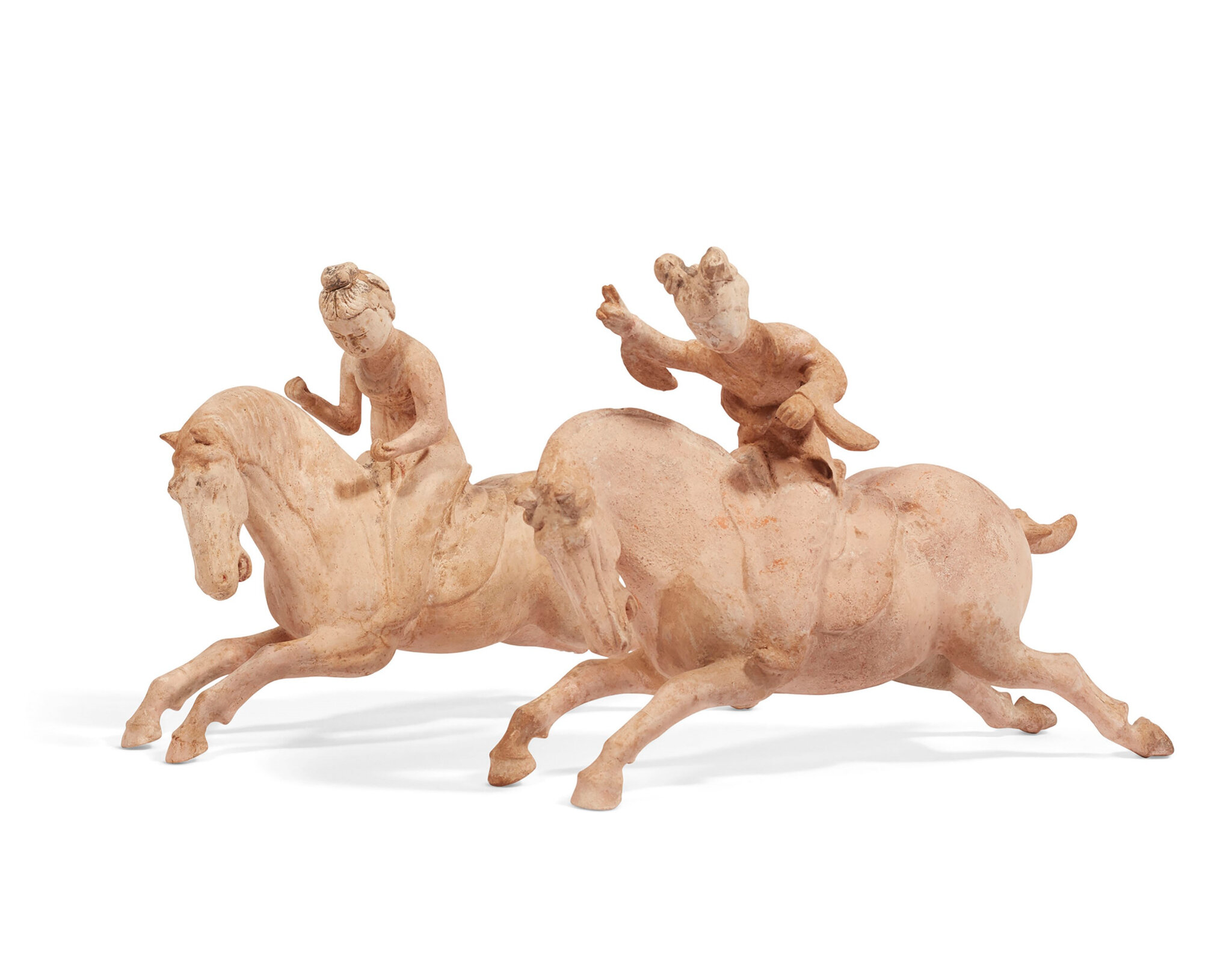 A pair of Chinese painted pottery figures of female polo players, Tang dynasty (618-907)