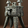 An extremely rare and important archaic bronze wine vessel and cover, (fangjia), late shang dynasty, 13th - 11th century bc