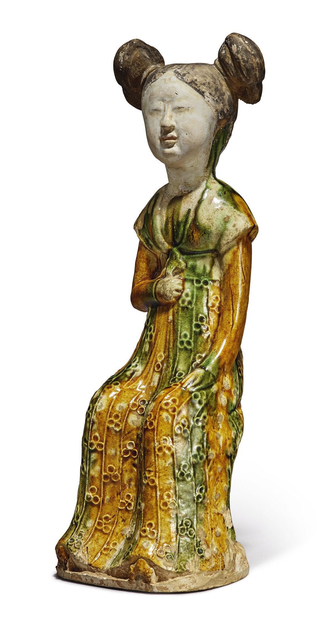 A sancai-glazed pottery figure of a seated court lady, Tang dynasty (618-907)