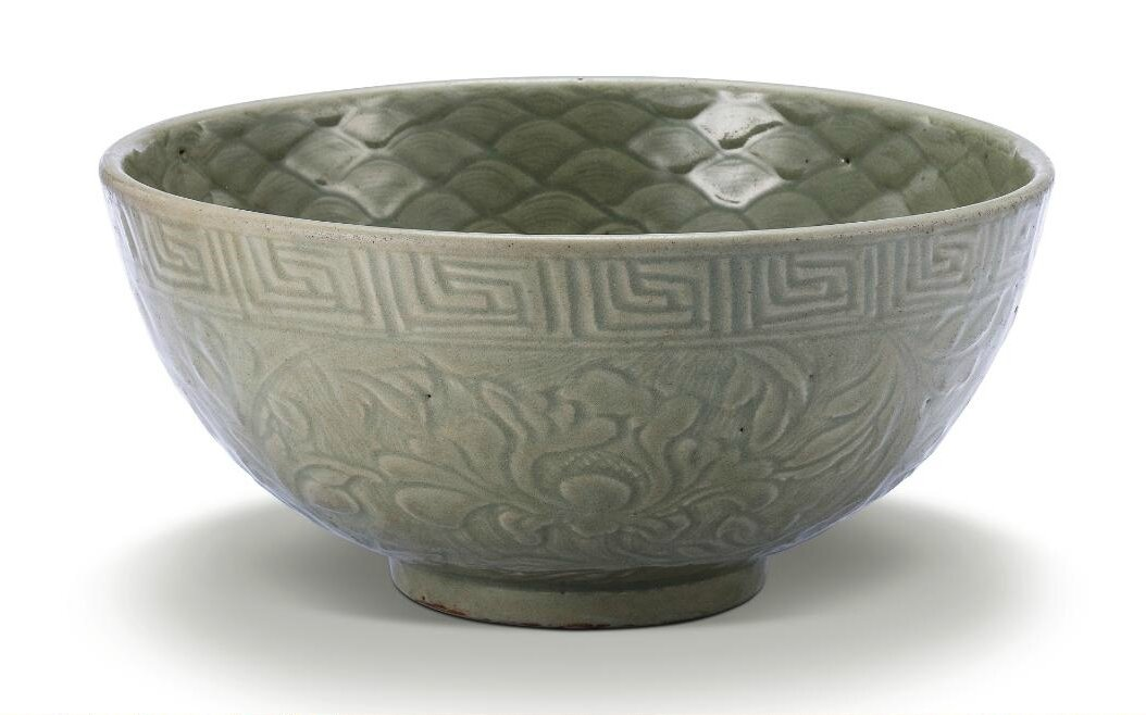A large carved 'Longquan' celadon bowl, Ming dynasty, 15th century