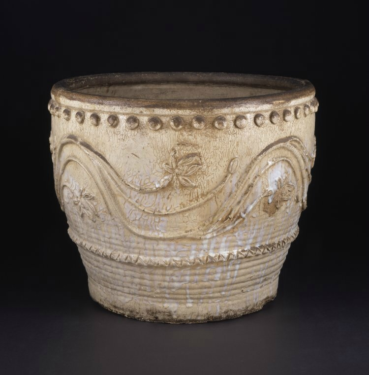 Large vat with moulded decoration, cream glaze and iron-brown rim, Vietnam, Ming dynasty, circa 1600-1644. Height: 60 centimetres. Diameter: 74 centimetres. Purchased from George Eumorfopoulos.Bought with the help of public subscription. 1938,0524.117. Bri