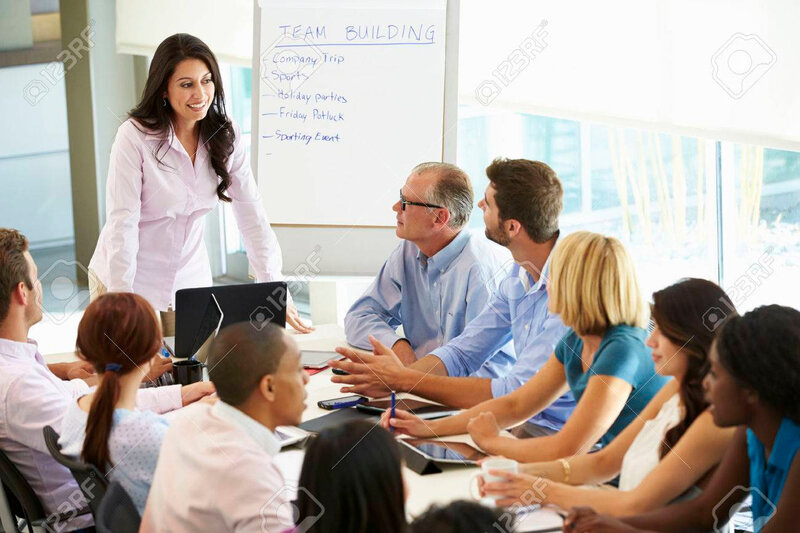 31047567-businesswoman-addressing-meeting-around-boardroom-table
