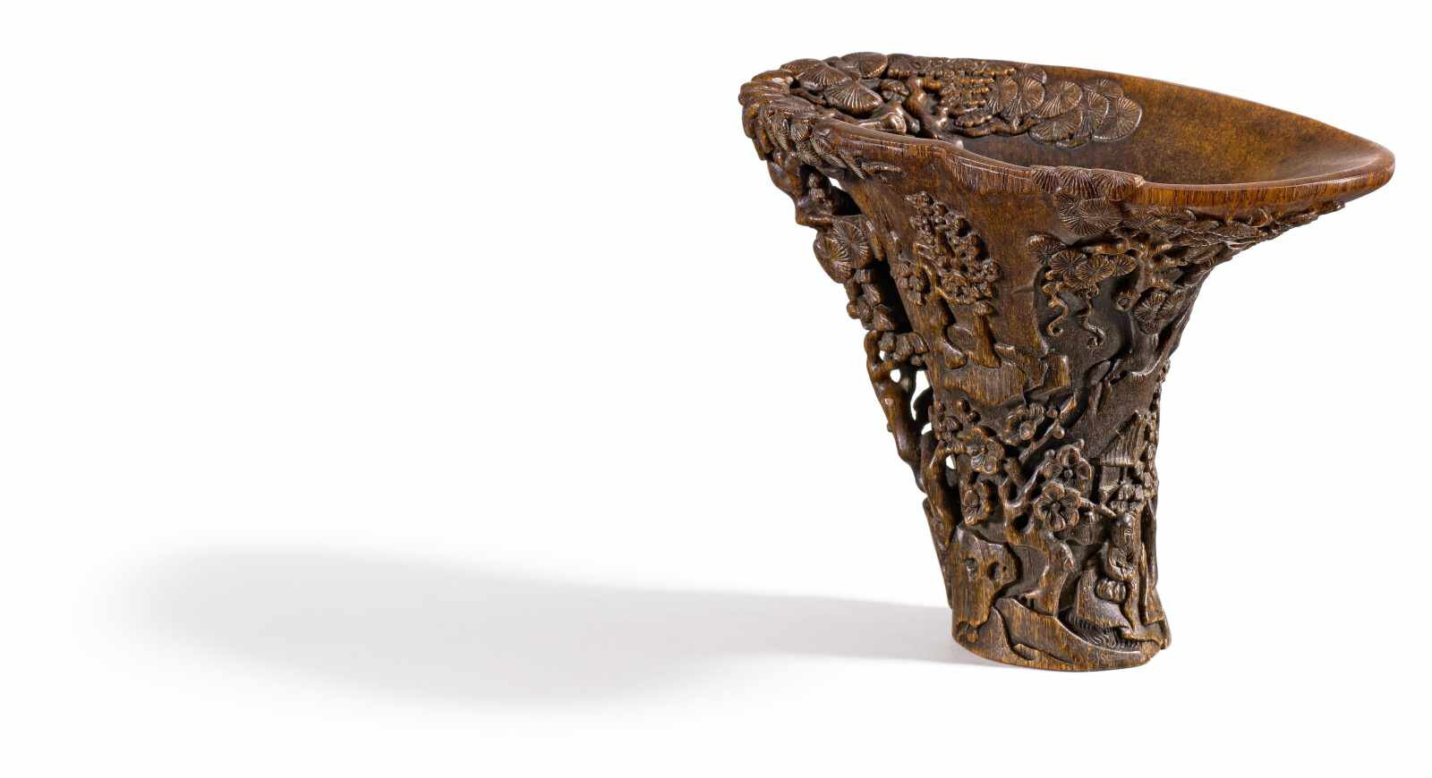 Elegant rhinoceros horn libation cup with ermit in a landscapeith high pines, China, Late Qing dynasty