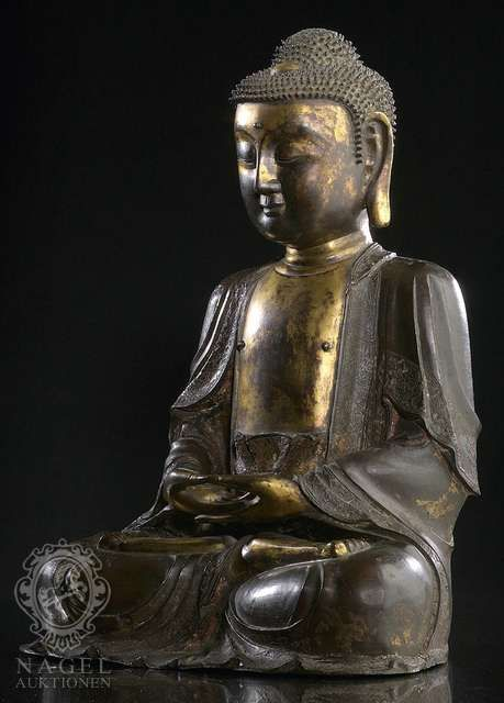 a very fine part-gilt bronze figure of seated buddha  china  ming dynasty  15th  16th ct