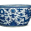 An exceedingly rare massive blue and white 'dragon' basin, Longqing six-character mark in a line in underglaze blue and of the period (1567-1572)