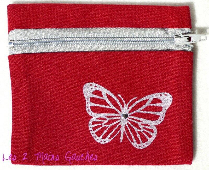 porte-monnaie rouge et gris avec papillon peint