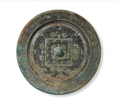 A large bronze 'TLV' circular mirror, China, Western Han-Xin dynasty, 1st Century AD