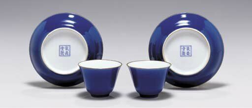 A pair of blue-glazed cups and saucers, Jing wei tang zhi four-character marks in underglaze blue within a double circle, 18th century