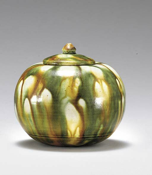 A small sancai-glazed pottery globular jar and cover, Tang dynasty (618-907)