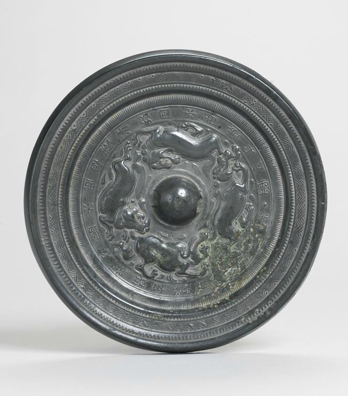 A bronze 'Mythical Beasts' mirror with inscription, Sui-Early Tang dynasty