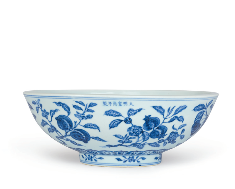 An extremely rare and fine large blue and white 'fruit spray' bowl, Xuande six-character mark in underglaze blue in a line at the rim and of the period (1426-1435)