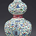 An unusual wucai double-gourd-form vase, Wanli period (1573-1619)