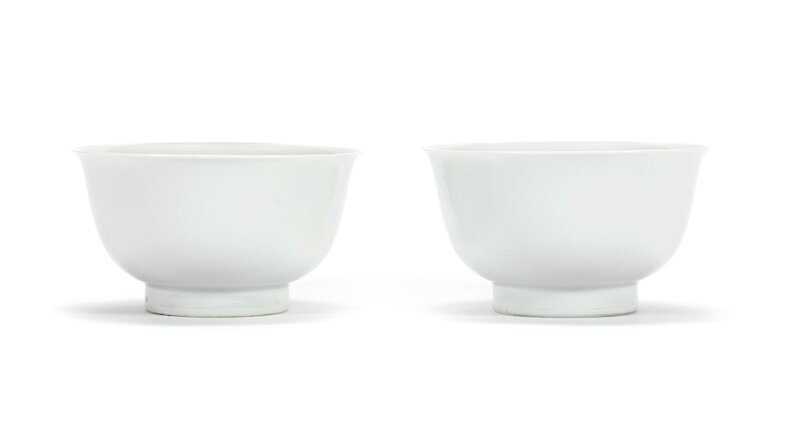 A rare pair of white-glazed anhua 'dragon' bowls, Chenghua six-character marks, 17th-18th century
