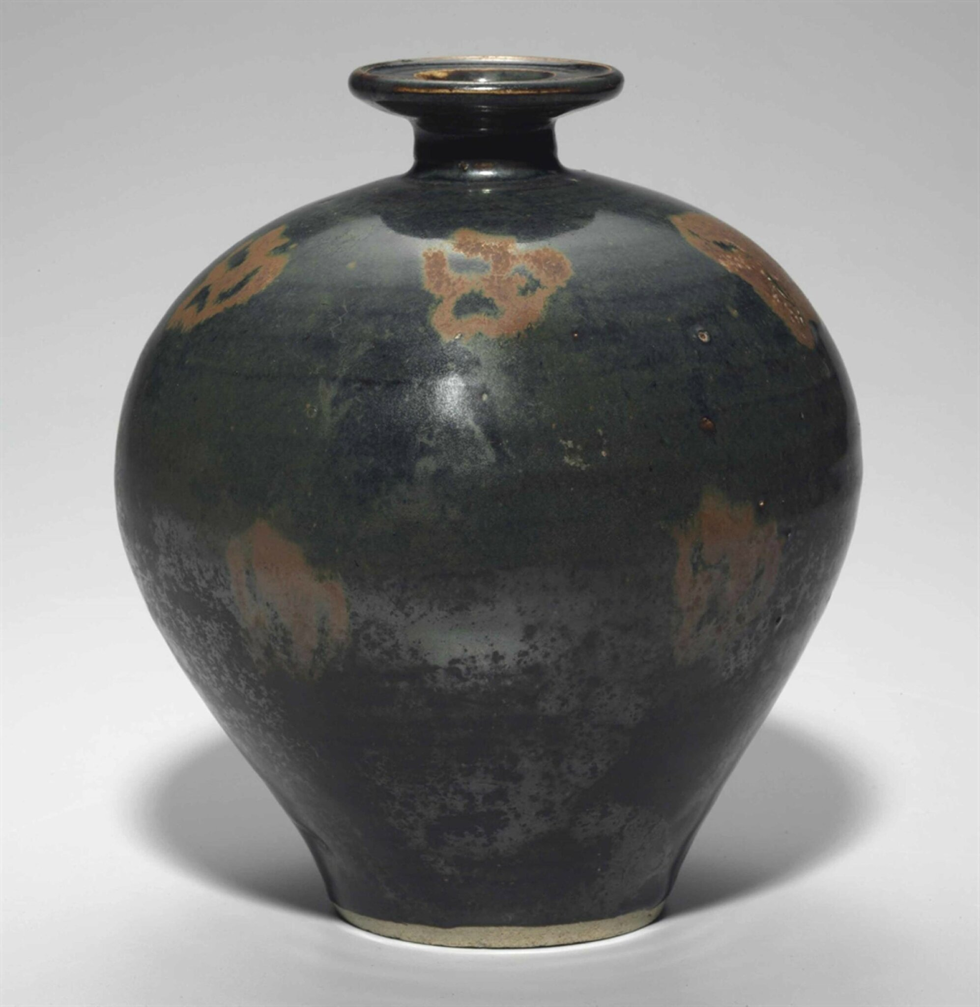 A rare russet-decorated blackish-brown-glazed jar, Northern Song dynasty, 11th-12th century