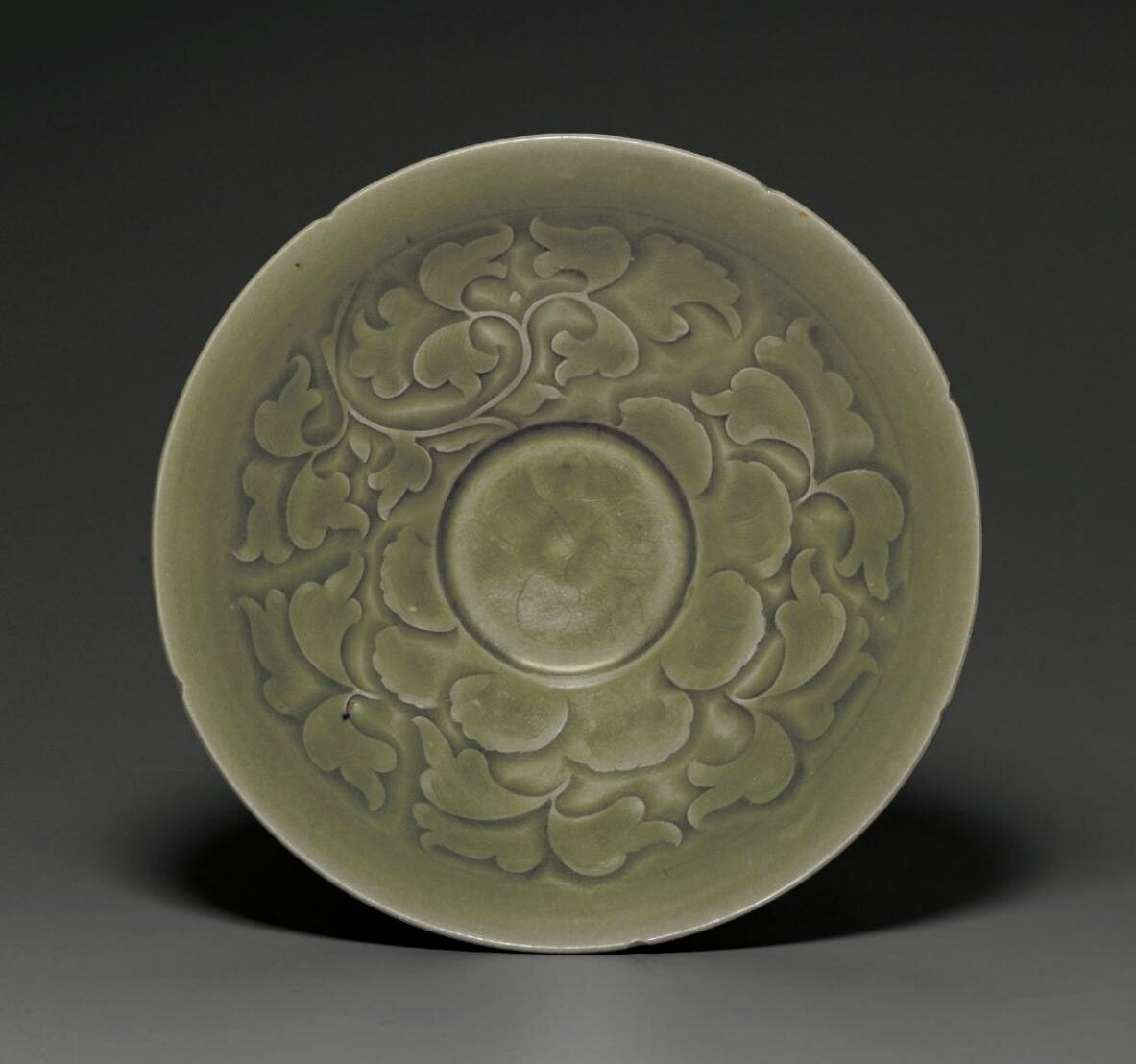A rare carved Yaozhou 'Peony' bowl, Northern Song dynasty, 11th-12th century