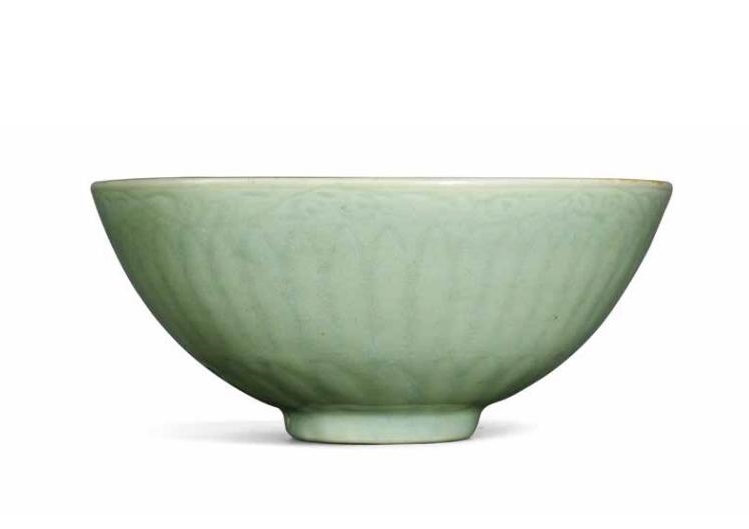 A Longquan Celadon Carved 'Floral Scroll' Bowl, Early Ming Dynasty, Early 15th Century