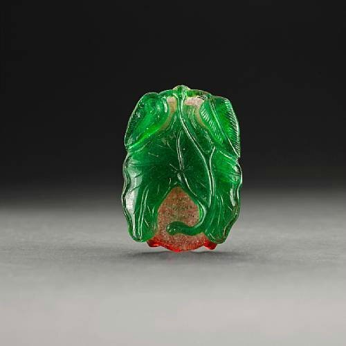 A red, snowflake white and green glass cicada. Photo Bonhams