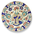 A rare kubachi figural pottery dish, persia, safavid, early 17th century