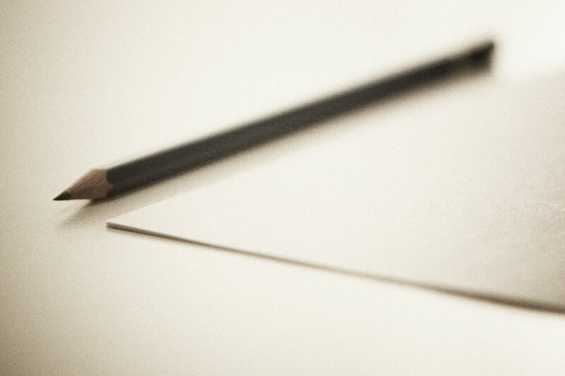Sharpened_pencil_next_to_sheet_paper