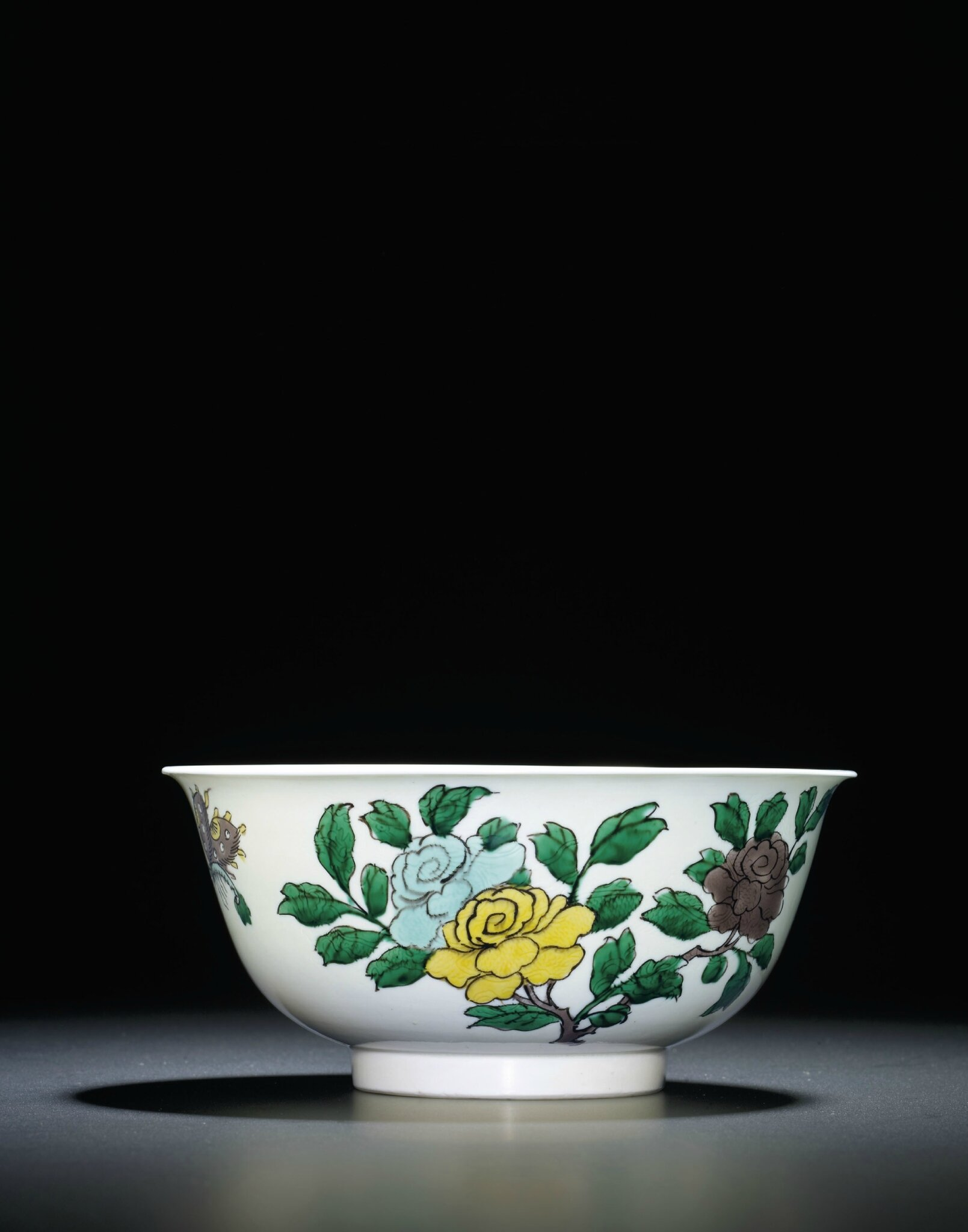 A fine famille verte 'dragon' incised bowl, Kangxi six-character mark within a double circle and of the period (1662-1722)