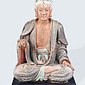 A large polychrome figure of buddha, early ming dynasty, 14th century