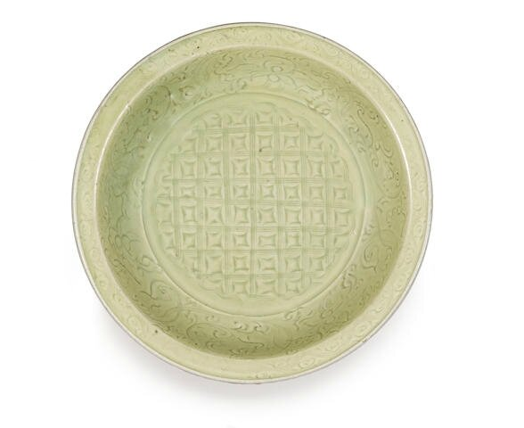 A large Longquan celadon-glazed carved dish, 15th century