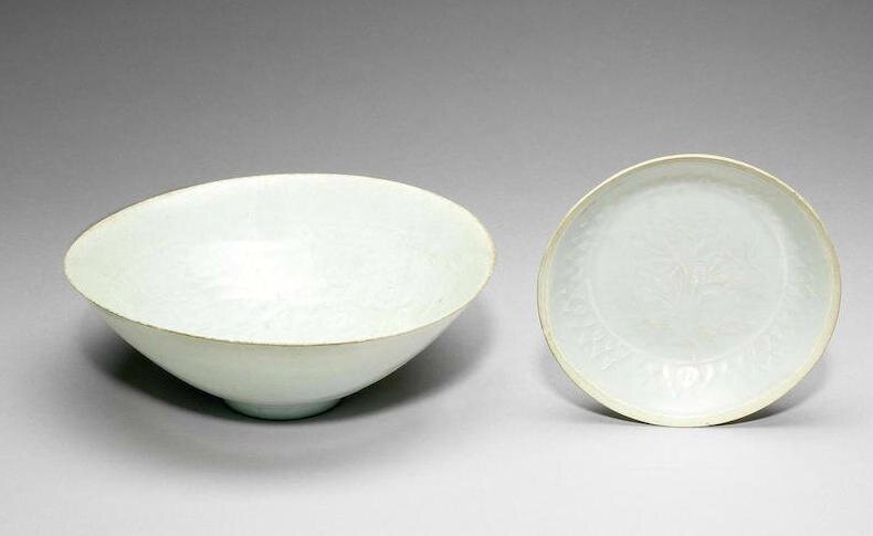 A Qingbai carved conical 'boys and peony' bowl, Southern Song Dynasty