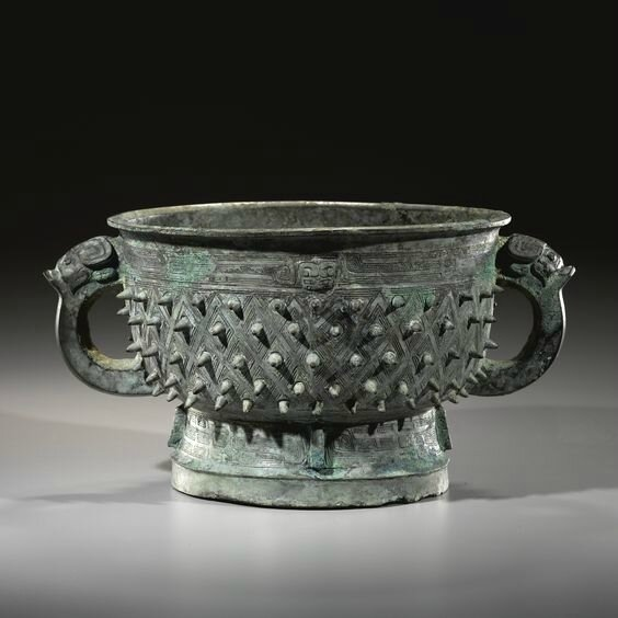 A fine archaic bronze ritual food vessel, gui, Late Shang dynasty (c