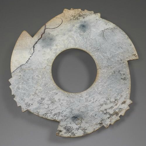 A very rare and important large jade notched disc, xuanji, late Neolithic Period to Shang Dynasty, ca 2000-1200 BC