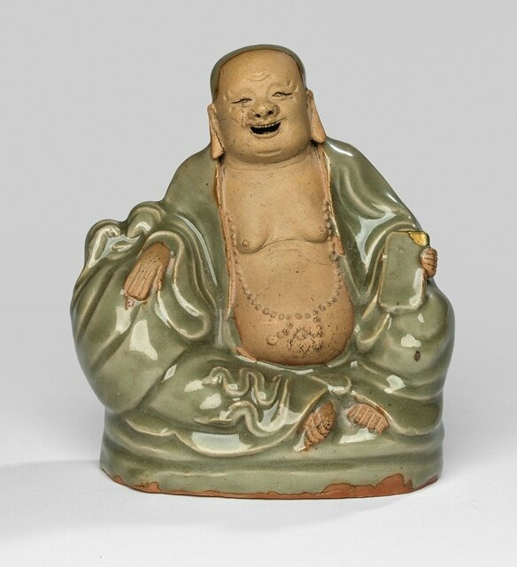 A rare Longquan model of a seated Budai, Ming dynasty