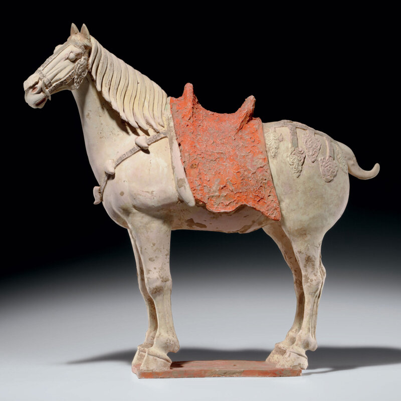 A painted pottery figure of a caparisoned horse, Tang dynasty (618-907)